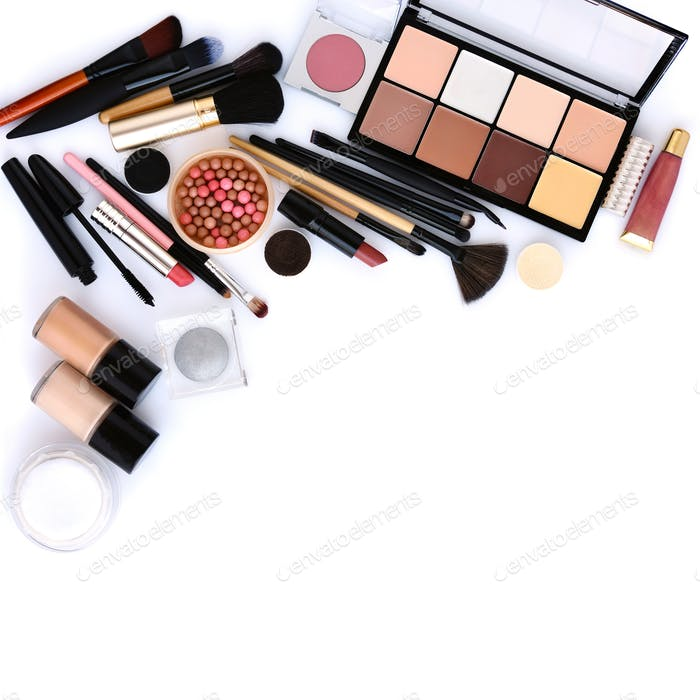 Makeup brush and decorative cosmetics on a white background with