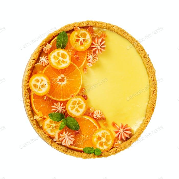 Cheesecake with slices of orange and kumquat isolated on white