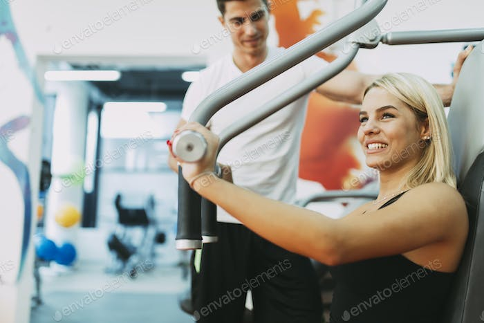 Beautiful woman exercising in gym