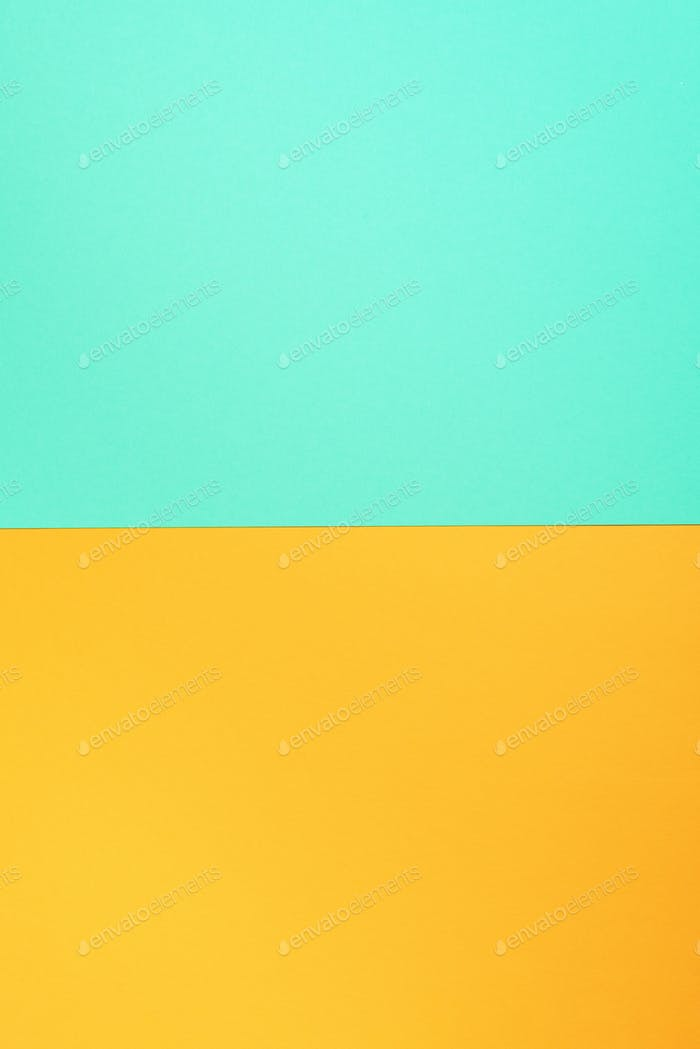 Background in trendy green and yellow colors. Fashionable paper. Top view. Minimal concept. Trendy