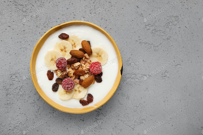 Yogurt with granola in bowl