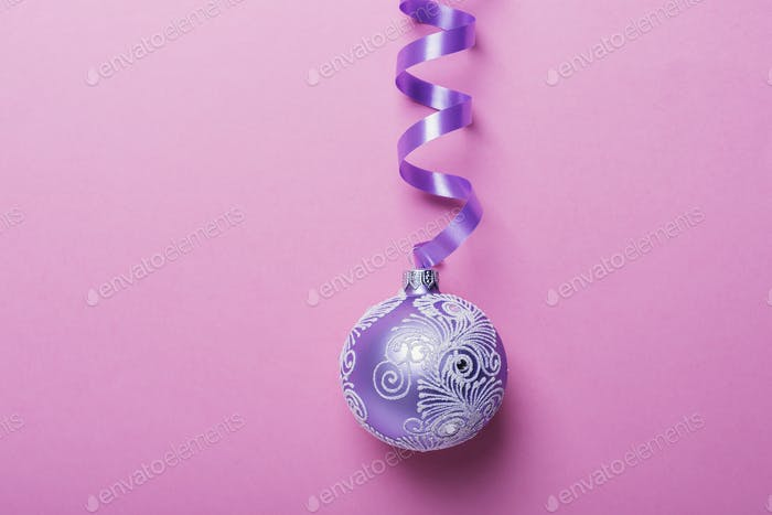 Christmas violet ball on the pink background