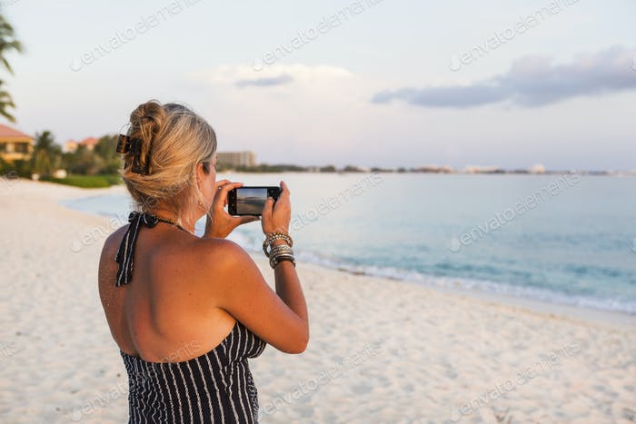 adult woman taking picture with a smart phone