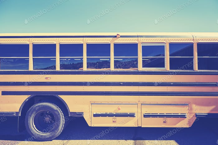Retro stylized close up picture of a school bus side