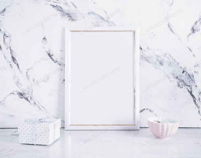 Blank frame and craft box over marble table