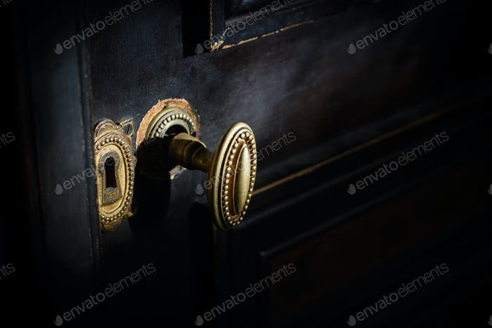 detail of antique golden door handle knob