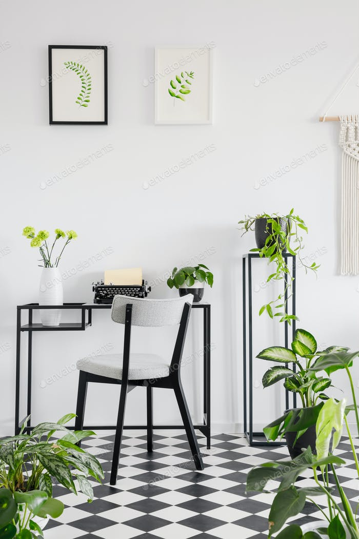 Botanical home office interior with a desk, chair and graphics o