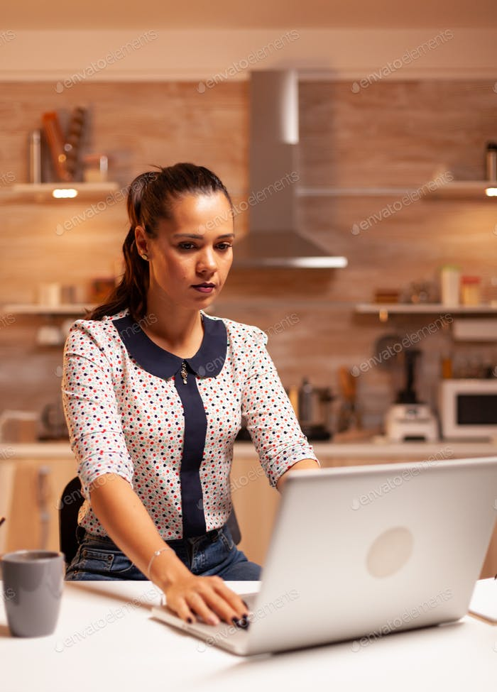 Woman working on computer during a deadline