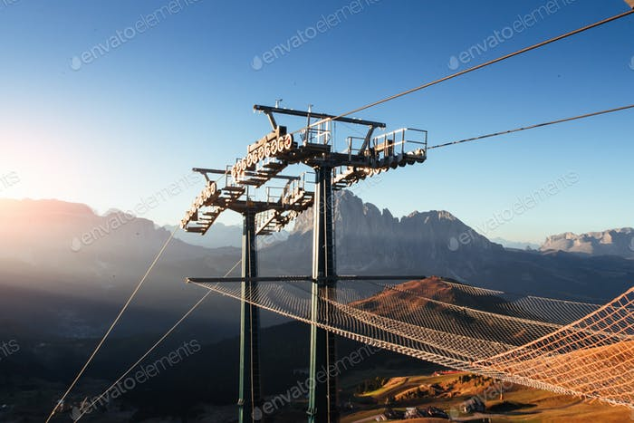 Ready to go down. Cableway standing on the hills in Seceda dolomites