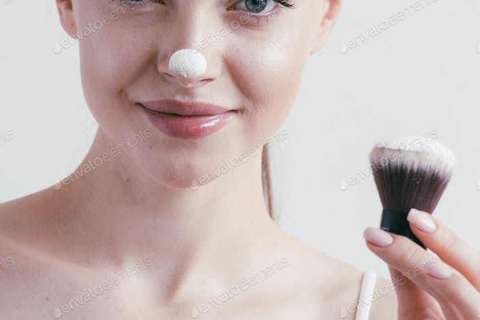 Make-up-Pulver Frau Gesicht csmetic Schönheit