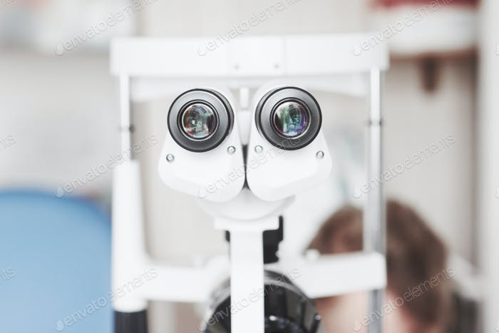 Front view of the professional optician's device for eye examination