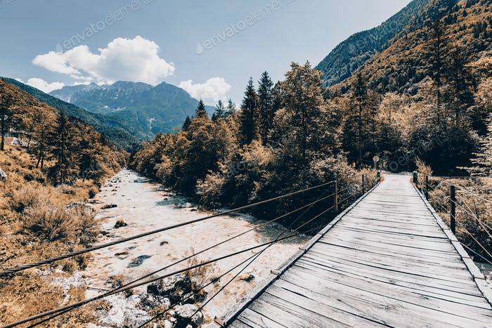 Wooden Bridge over rover Soca, Slovenia at autumn