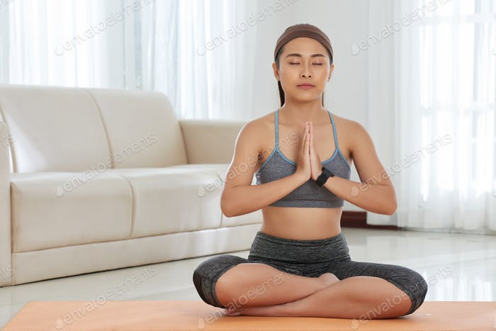 Woman Practising Meditation At Home
