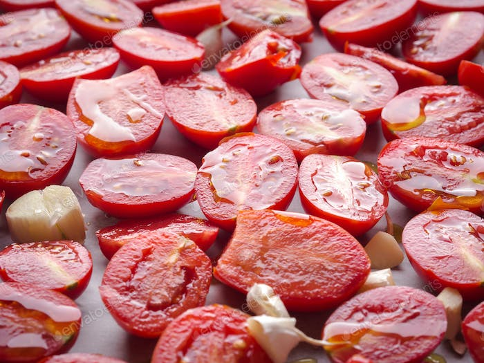 Red heirloom tomatoes with olive oil