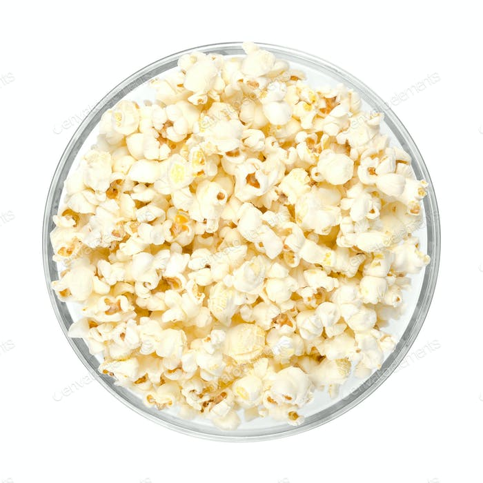 Popped popcorn in glass bowl over white