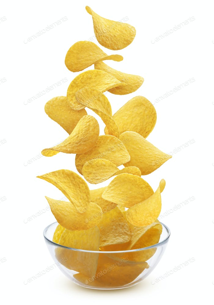 Delicious crispy potato chips pile in glass bowl