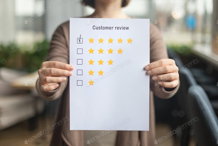 Woman choosing with tick five star rating on paper sheet