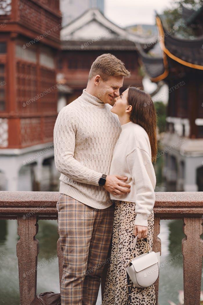 newlywed couple showing affection in Shanghai near Yuyuan