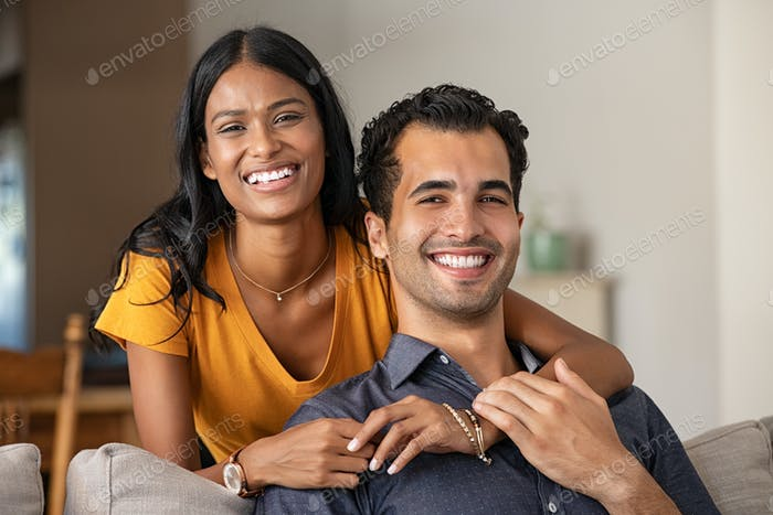 Happy indian couple at home portrait
