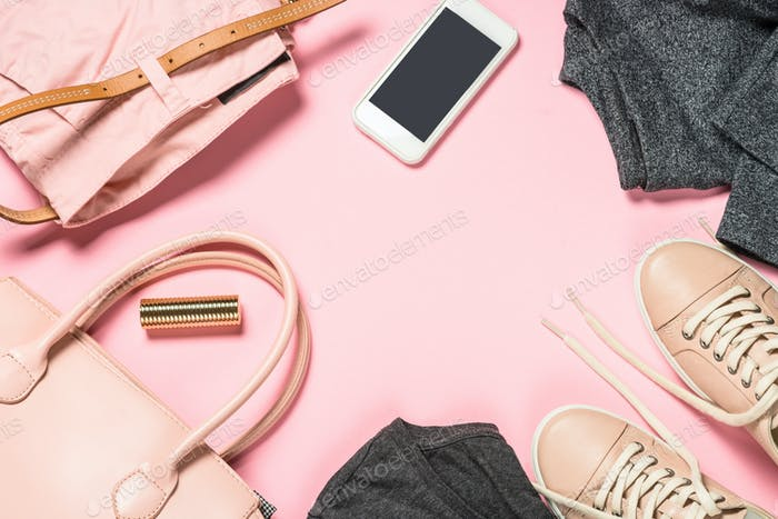 Woman fashion cloth and accessories on pink background