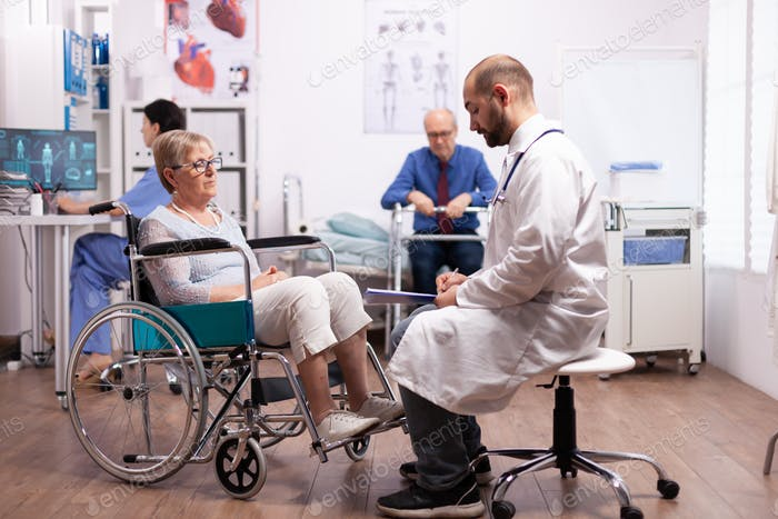 Elderly woman in wheelchair at doctor appointment