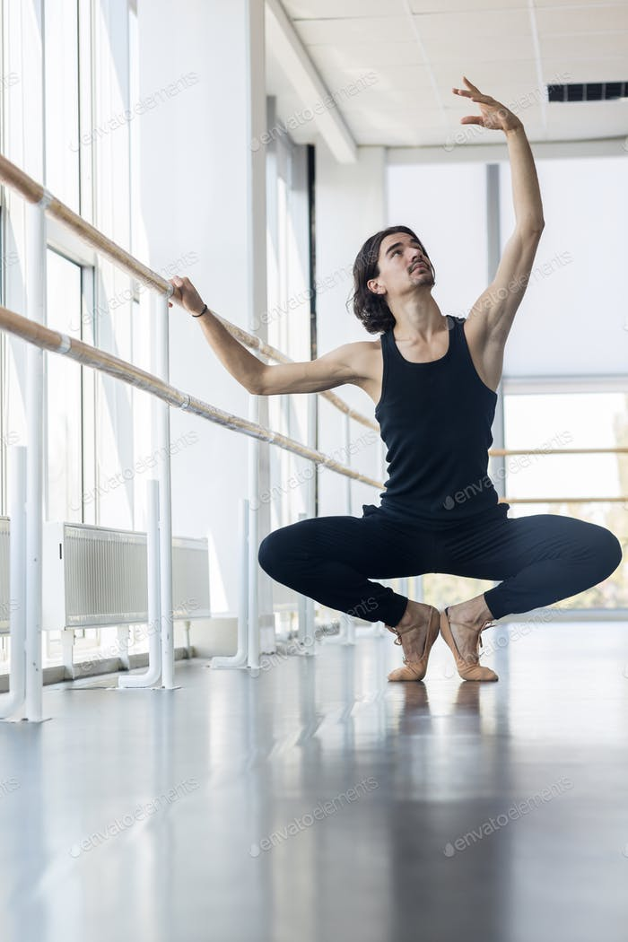 Young Male Ballet Dancer Posing Near Barre, Man Practicing In