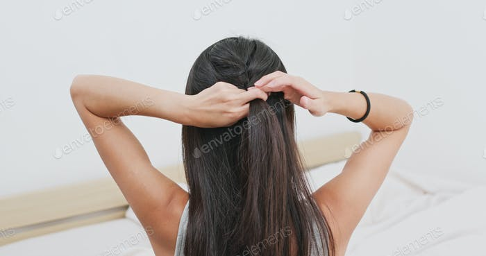 Woman tied her in braid at home