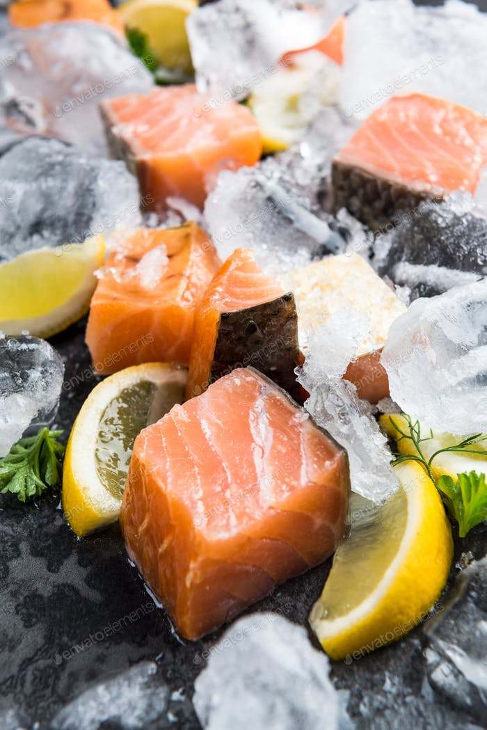 Cold smoked salmon pieces on ice cubes