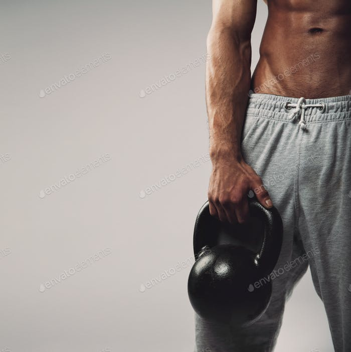 Kettlebell in young man's hand
