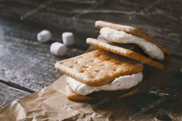 Smores on the parchment  on the  wooden table