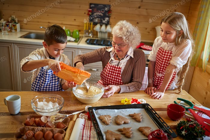 granny making Christmas cookies with kids