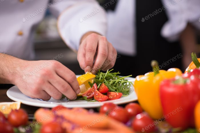 chef serving vegetable salad