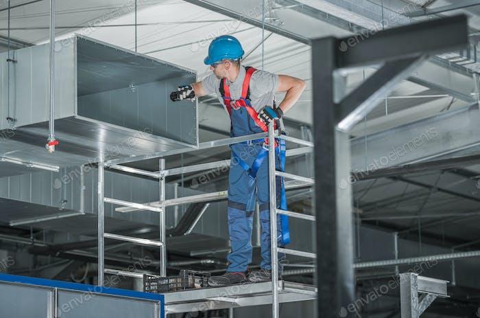 HVAC Worker Looking Inside Air Duct