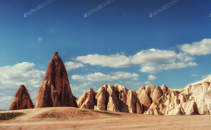 Beautiful Cappadocia on the background of blue sky with white