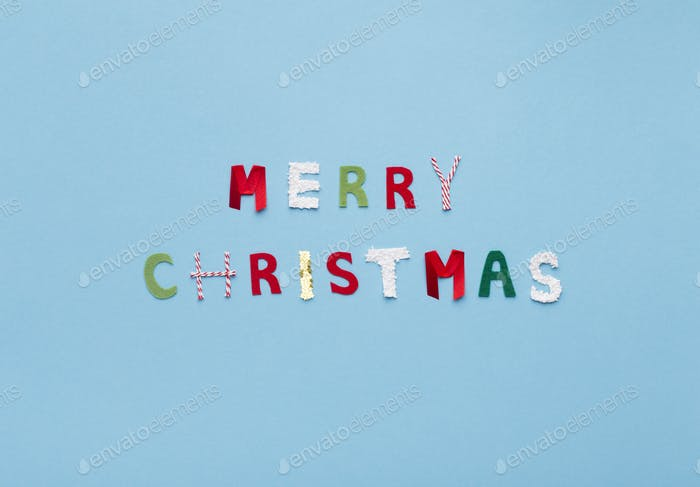 Merry Christmas text of colored letters on blue background