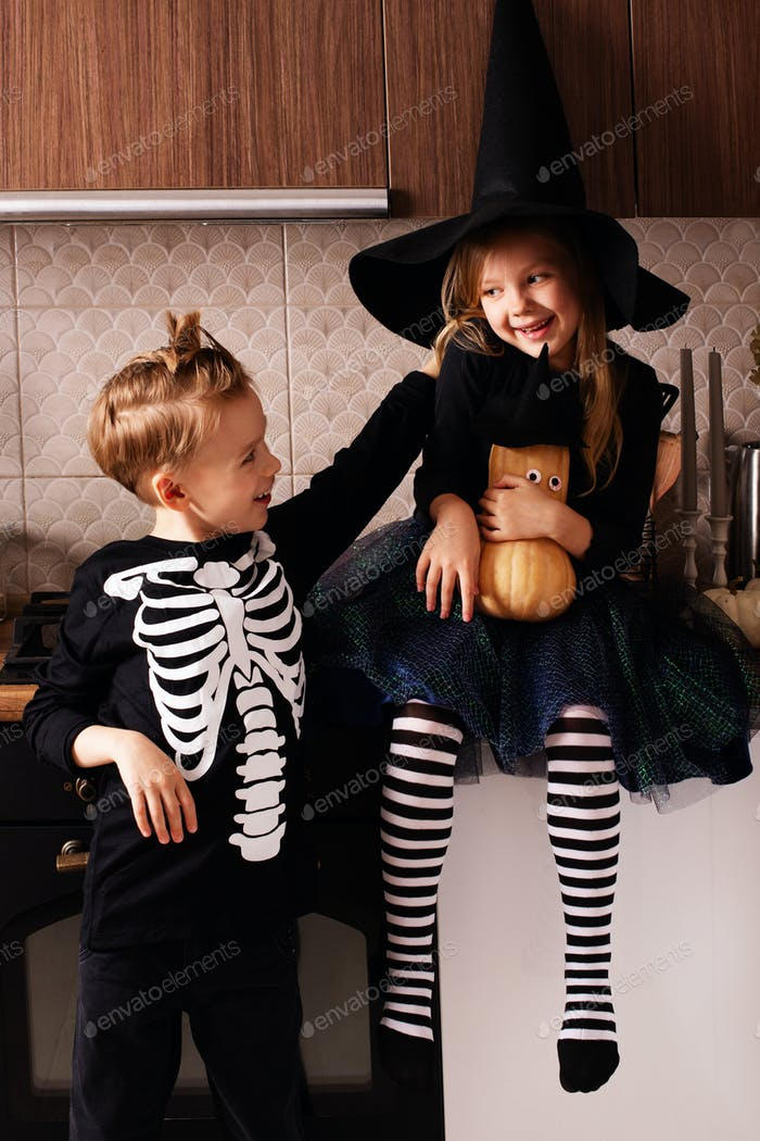 Halloween lifestyle party with caucasian kids at home