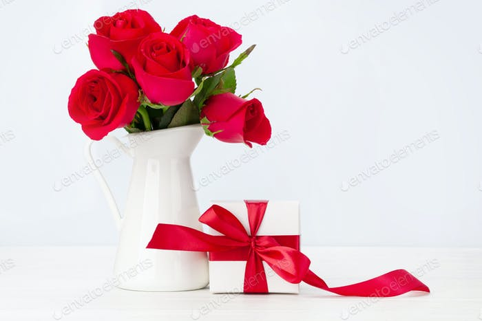 Valentines day greeting card with red rose flowers