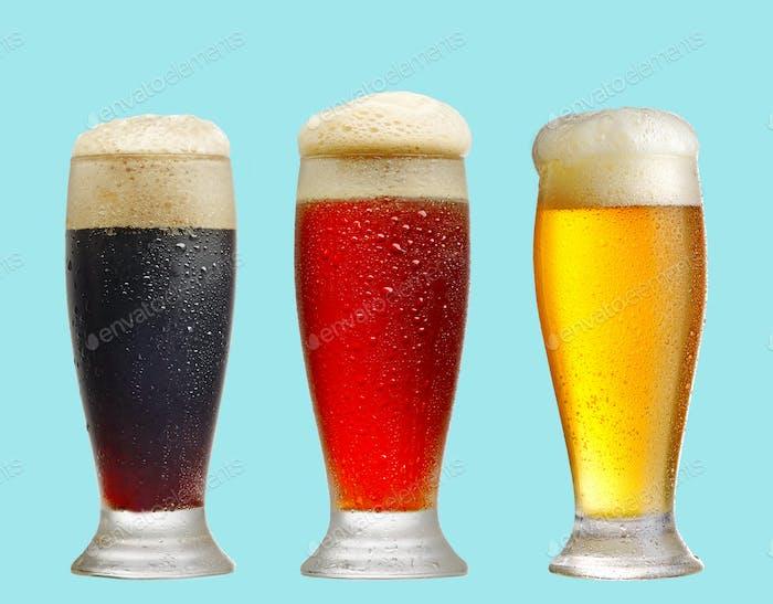 various beer glasses on blue background
