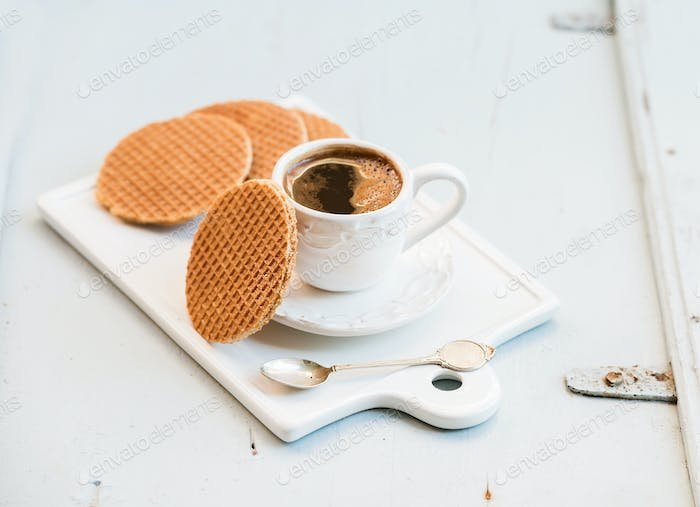 Dutch caramel stroopwafels and cup of black coffee