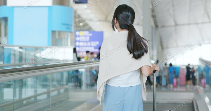 Woman go for a trip in the airport