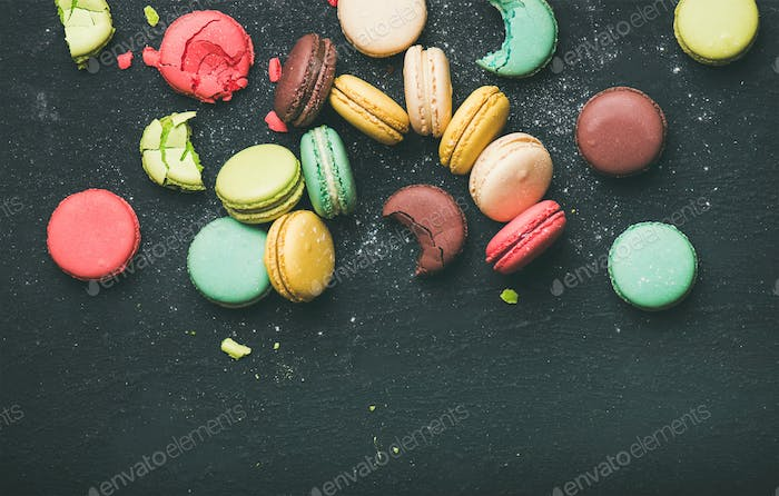 Flat-lay of sweet colorful French macaron cookies