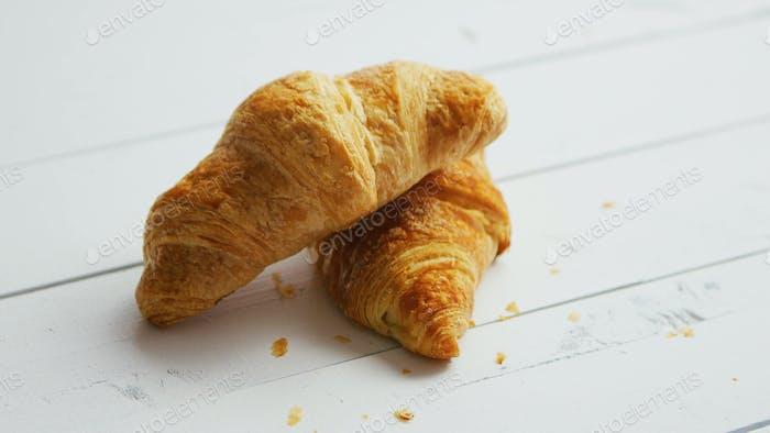 Fresh croissants on table