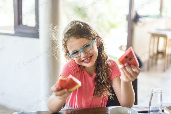 A girl holding watermelon