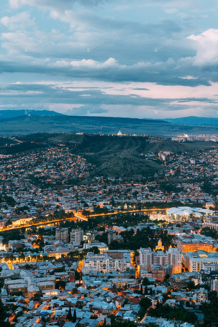 Tbilisi Georgia. Aerial Cityscape View In Evening Illimination,