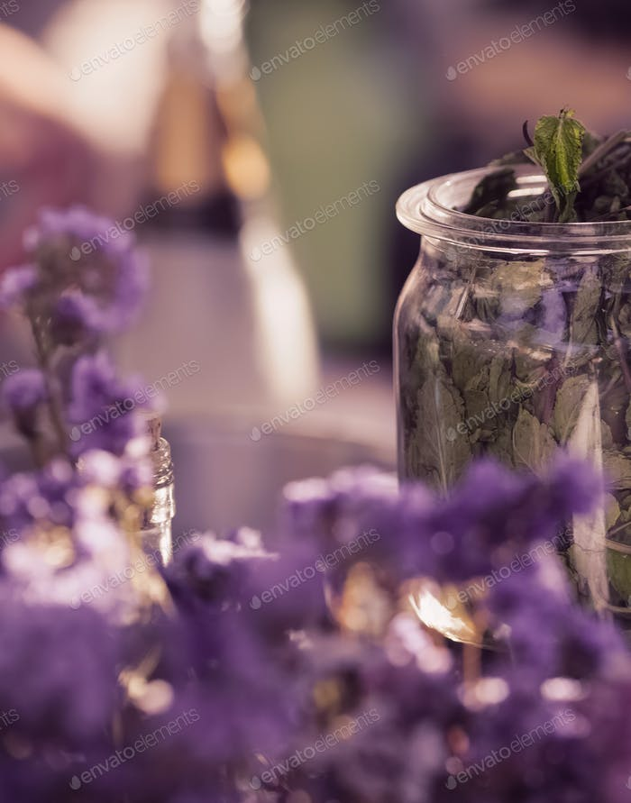 Dried lilac wildflowers and jar with dried mint