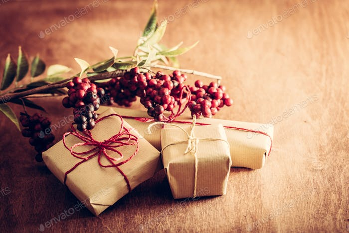 Rustic retro gift, present boxes with decorations. Christmas time, eco paper wrap.
