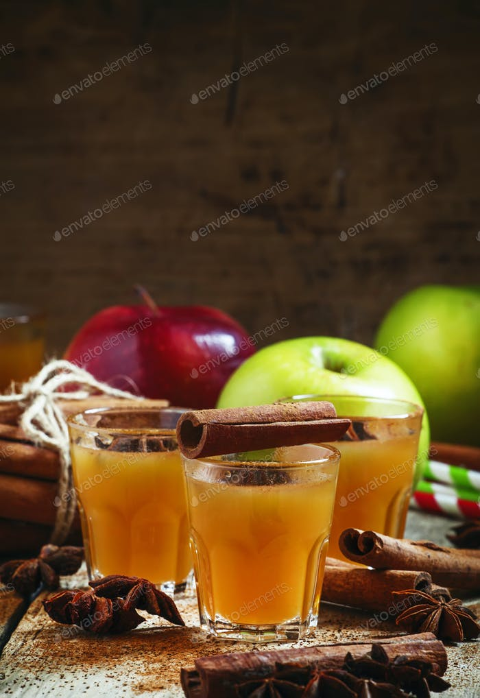 Apple cider with cinnamon and anise, selective focus