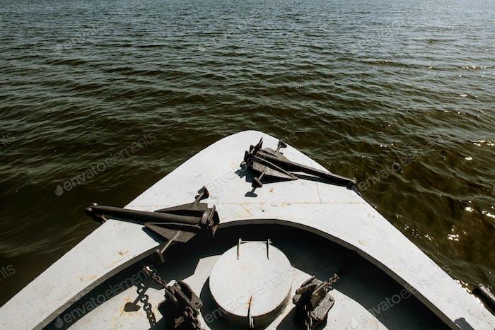 sailing on  boat at sunny lake at the city, summer vacation concept