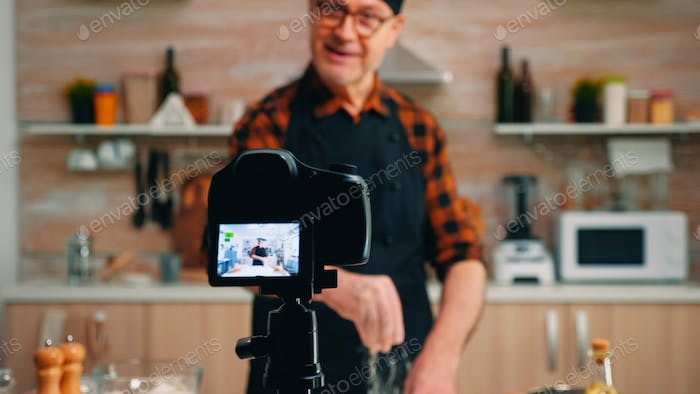 Man streaming live culinary podcast