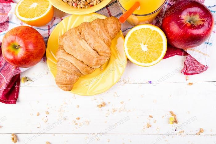 Healthy Breakfast. Various Assortment Set. Orange Juice, Granola, Croissant, and Fruit.